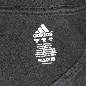 énorme réduction 1800c dfd09 Impossible is Nothing Adidas mens shirt black Bin5